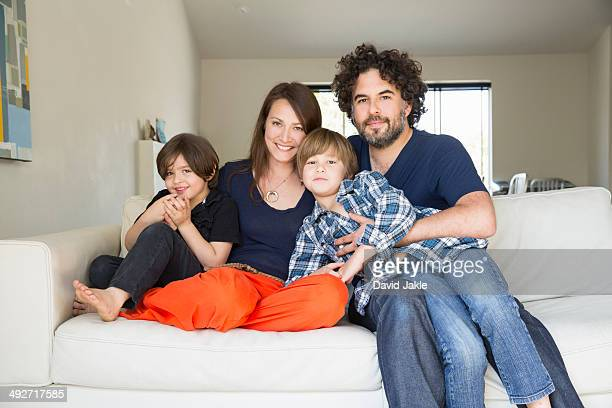 Portrait of family with two boys on sofa