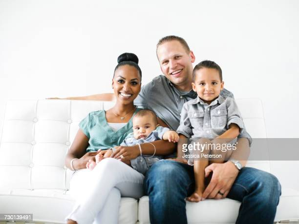 Portrait of family with two children (2-5 months, 2-3)
