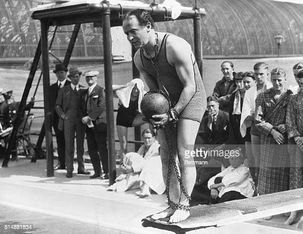 Portrait of famous escape artist Harry Houdini on diving board with ball and chain