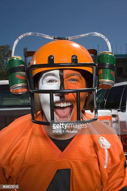 Portrait of fan with beer helmet