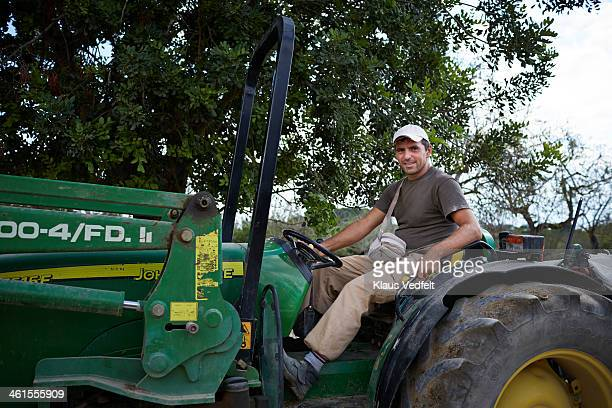portrait of farm worker sitting on tractor - klaus vedfelt mallorca stock pictures, royalty-free photos & images