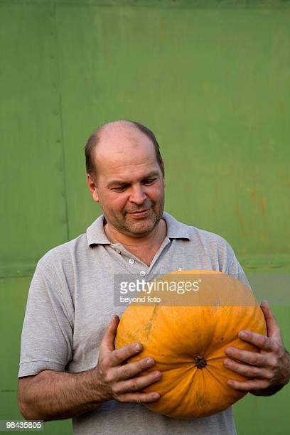 portrait of farmer holding pumpkin