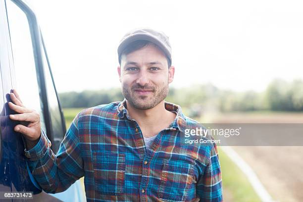 portrait of farmer looking at camera smiling - sigrid gombert stock pictures, royalty-free photos & images