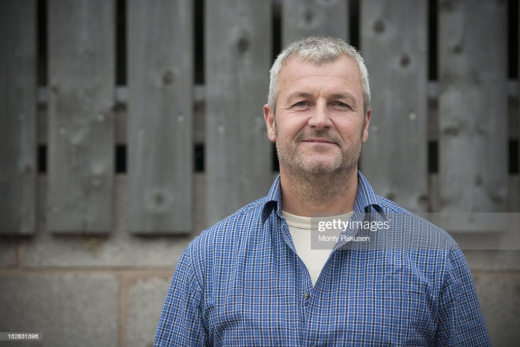 Portrait of farmer smiling, head and shoulders : Stock-Foto