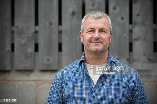 portrait of farmer smiling, head and shoulders - mature men stock pictures, royalty-free photos & images