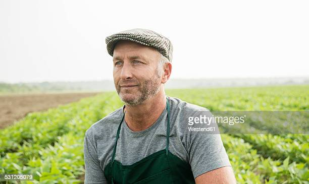 Portrait of farmer standing in front of a field