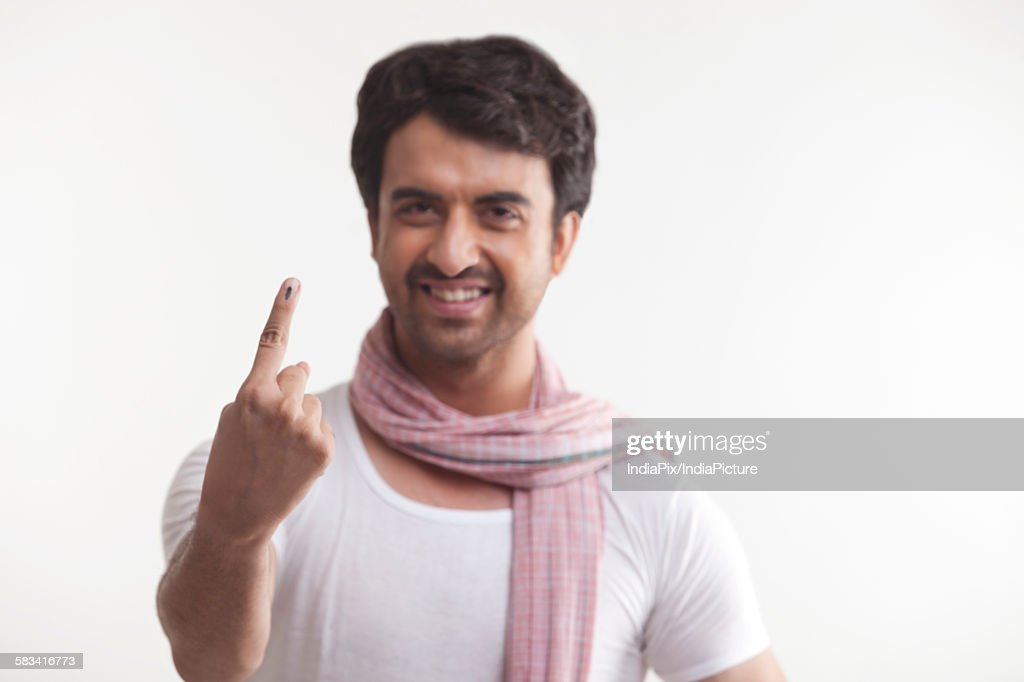Portrait of farmer with voters mark on finger : Stock Photo