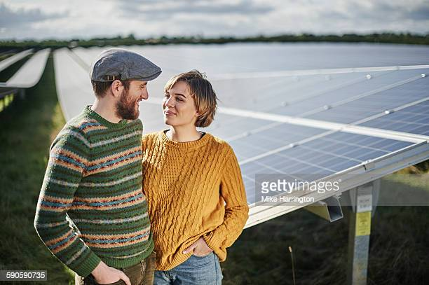 Portrait of farming couple in their solar farm