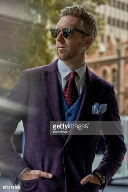 portrait of fashion blogger steve wearing sunglasses and suit - purple suit stock pictures, royalty-free photos & images