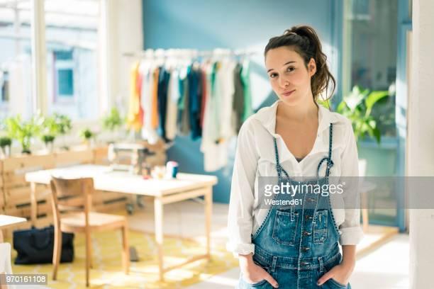Portrait of fashion designer in her studio