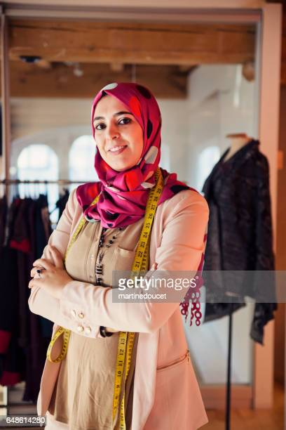 Portrait of fashion designer muslim woman in her work space.