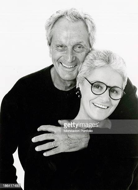 Portrait of fashion designer Ottavio Missoni while hugging his wife Rosita Missoni . Both are smiling and wearing a black shirt. Italy, the Nineties.