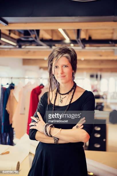Portrait of fashion designer woman in her work space.