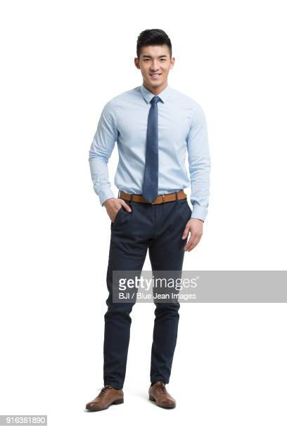 portrait of fashionable businessman - overhemd en stropdas stockfoto's en -beelden