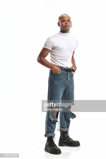 portrait of fashionable man in studio - modern manhood stock pictures, royalty-free photos & images