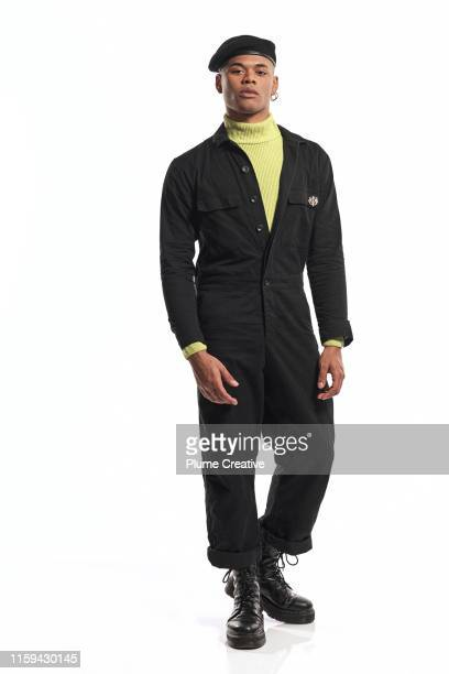 portrait of fashionable man in studio - military style stock pictures, royalty-free photos & images