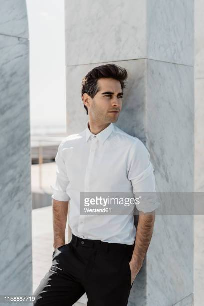 portrait of fashionable man weraing white shirt and black trousers - white shirt stock pictures, royalty-free photos & images