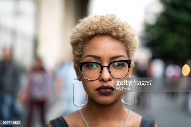 portrait of fashionable woman at city - short hair stock pictures, royalty-free photos & images
