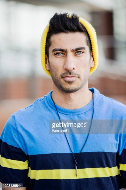 Portrait of fashionable young man wearing cap an striped t-shirt