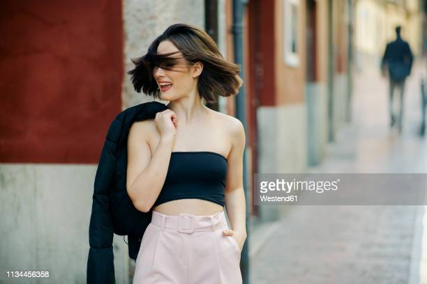 portrait of fashionable young woman in the city - off shoulder stock pictures, royalty-free photos & images