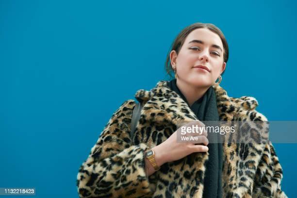 portrait of fashionable young woman. - farbquadrat stock-fotos und bilder