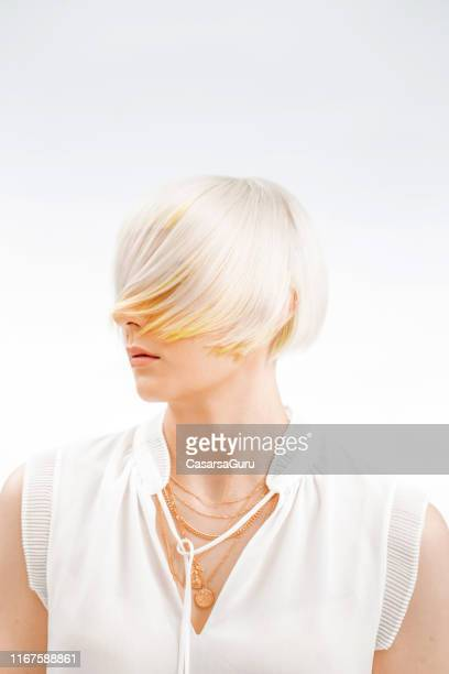 portrait of fashionable young woman with bleached hair covering her face - bleached hair stock pictures, royalty-free photos & images
