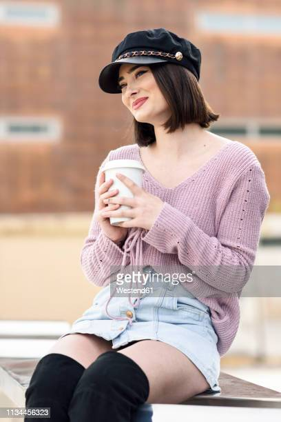 portrait of fashionable young woman with coffee to go - flat cap stock pictures, royalty-free photos & images
