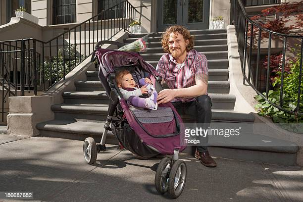 Portrait of father and child in stroller