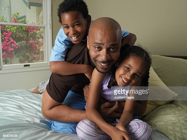 Portrait of father and children