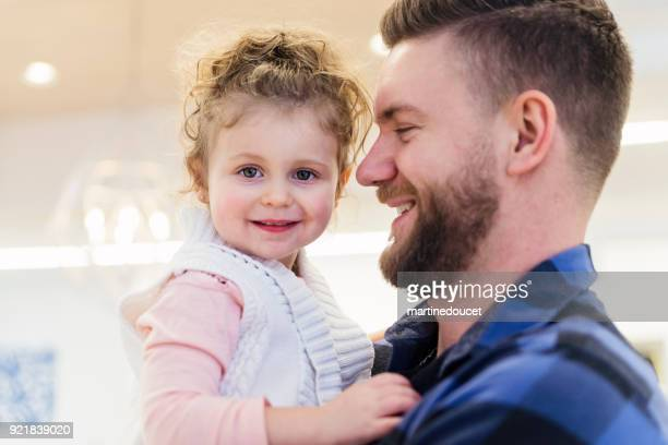 "portrait of father and daughter in a children store. - ""martine doucet"" or martinedoucet stock pictures, royalty-free photos & images"
