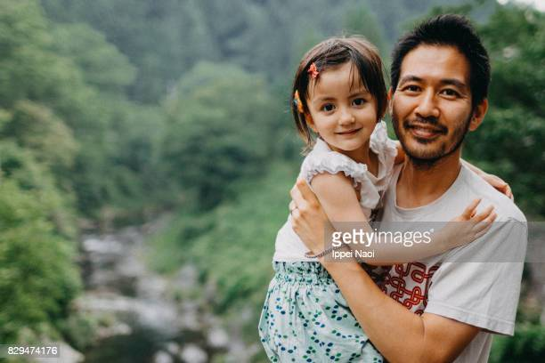 Portrait of father and daughter smiling at camera