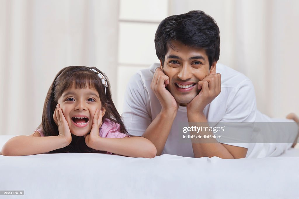 Portrait of father and daughter smiling : Stock Photo