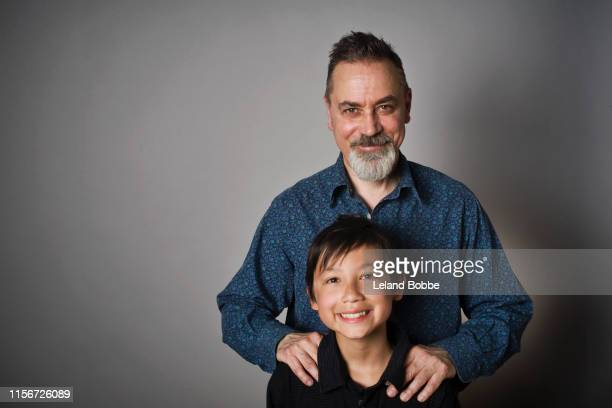 portrait of father and mixed race son - pre adolescent child stock pictures, royalty-free photos & images