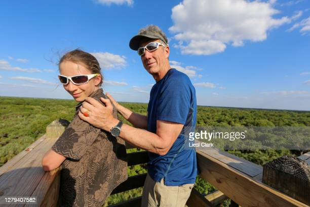 portrait of father and son above the tree canopy at myakka river state park, sarasota, fl - florida us state stock pictures, royalty-free photos & images