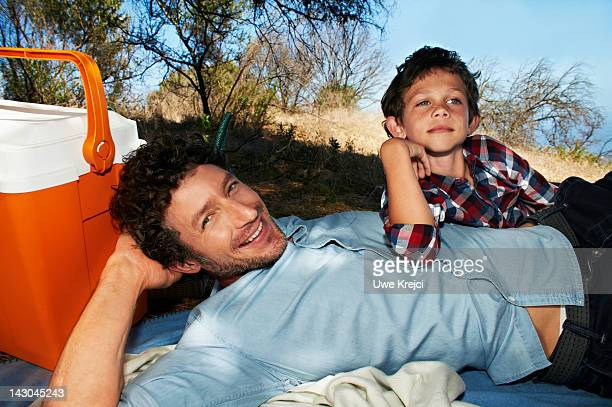 portrait of father and son at picnic - rolled up sleeves stock pictures, royalty-free photos & images