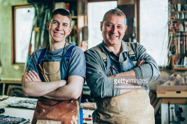 portrait of father and son carpenters - two generation family stock pictures, royalty-free photos & images