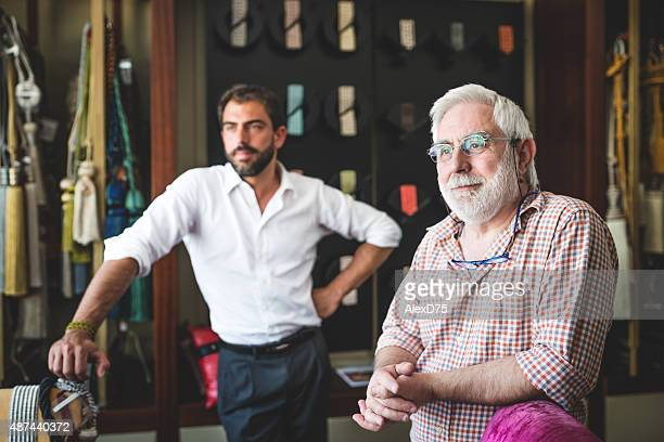 portrait of father and son entrepreneur - two generation family stock pictures, royalty-free photos & images