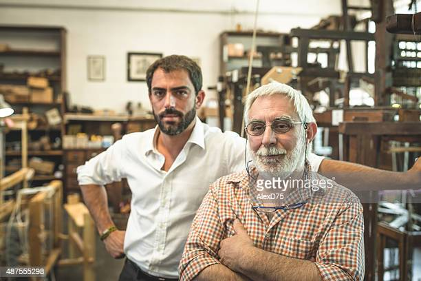 Portrait of Father and Son Entrepreneur