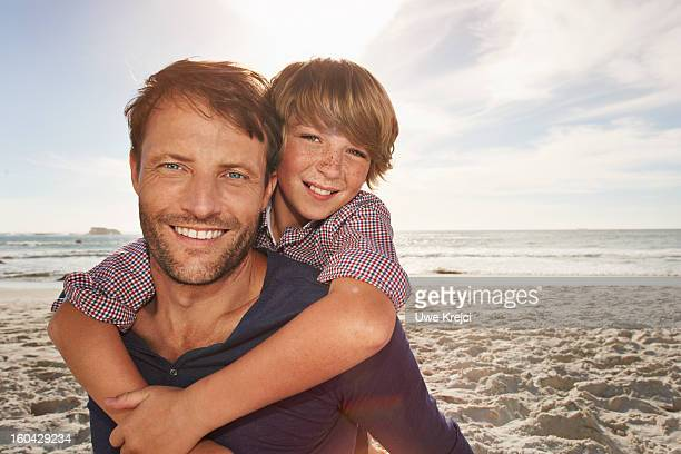Portrait of father and son hugging, outdoors
