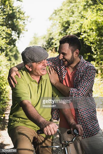 Portrait of father and son laughing together