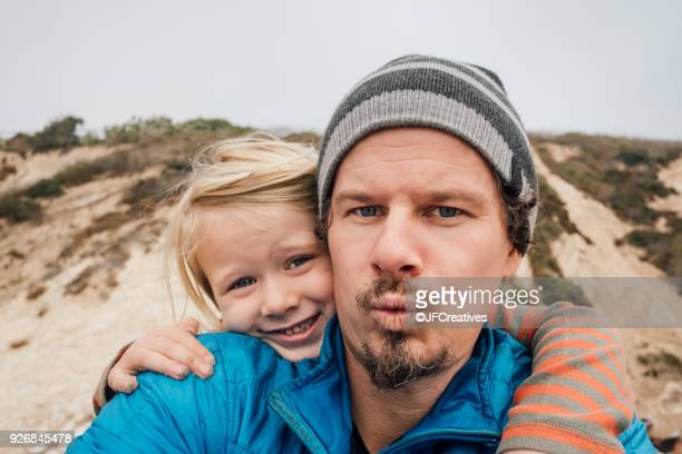portrait of father and son, outdoors, smiling, close-up - self portrait stock pictures, royalty-free photos & images