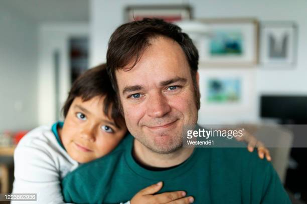 portrait of father at home with his son - patience stock pictures, royalty-free photos & images