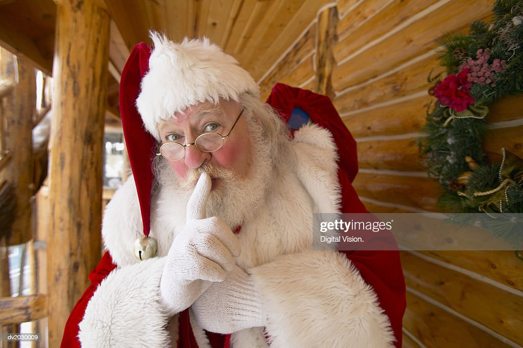 Portrait of Father Christmas With His Finger on His Lips : Stock Photo