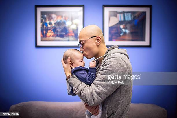 Portrait of father kissing son