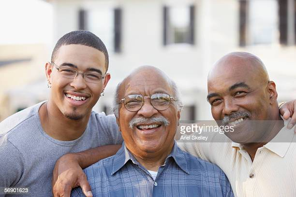 portrait of father son and grandfather - generation gap stock pictures, royalty-free photos & images
