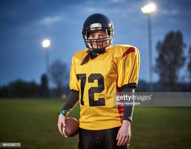 portrait of female american footballer in evening light - safety american football player stock pictures, royalty-free photos & images