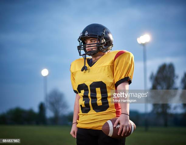 portrait of female american footballer - safety american football player stock pictures, royalty-free photos & images
