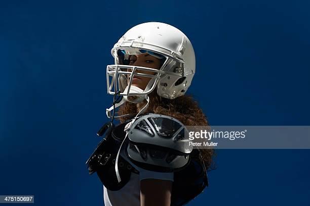 portrait of female american footballer wearing helmet - peter forte - fotografias e filmes do acervo