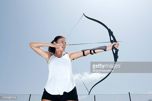 Portrait Of Female Archer Aiming