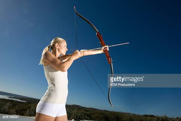Portrait of female archer aiming